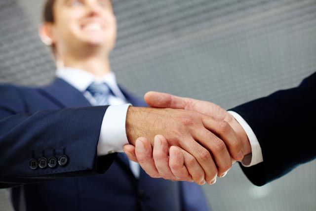 graphicstock two businessman shaking hands
